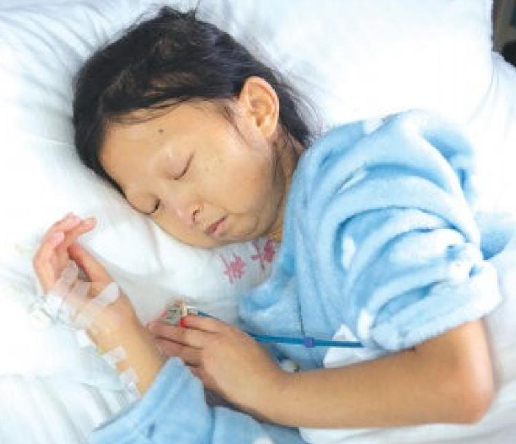 Wu Huayan điều trị trong bệnh viện ở thành phố Đồng Nhân, tỉnh Quý Châu hồi năm ngoái. Ảnh: SCMP/Weibo