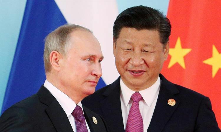 Tổng thống Nga Putin (trái) và Chủ tịch Trung Quốc Tập Cận Bình gặp nhau ở Nga hồi tháng 6/2019. Ảnh: Reuters.
