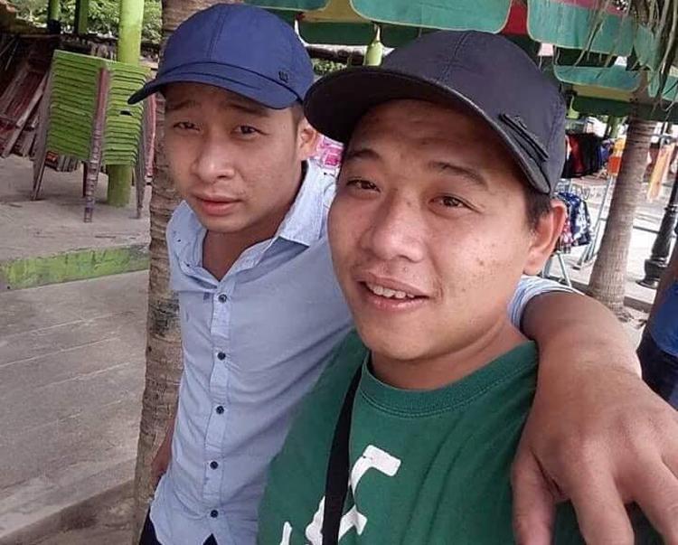 Tuấn (trái) và em họ Lê Quốc Minh. Ảnh: Người dân cung cấp.