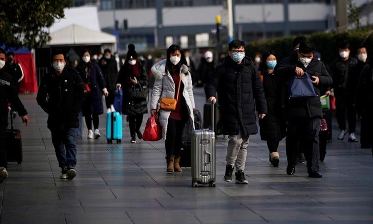 Người Trung Quốc rục rịch đi làm trở lại - ảnh 1