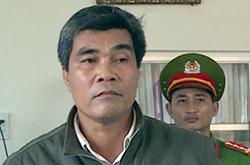 Ông Nguyễn Văn Tiên lúc bị bắt. Ảnh: An Nguyên.