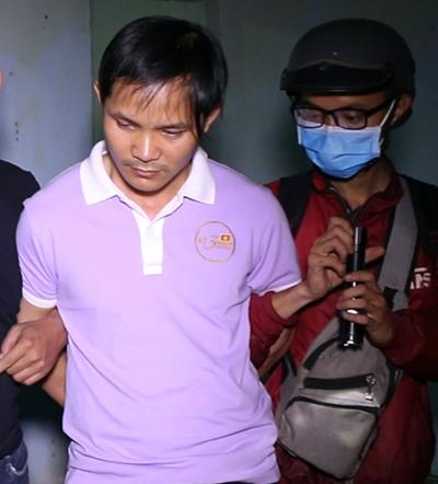 Hồ Thanh Ngân lúc bị bắt. Ảnh: Văn Trăm.