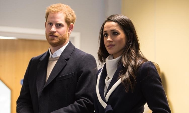 Harry và Meghan tại một sự kiện ở Điện Birmingham, Anh, ngày 8/3/2018. Ảnh: Reuters.