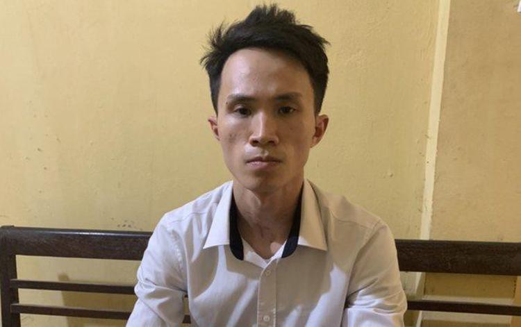 Hưng tại cơ quan điều tra. Ảnh: Minh Trang.