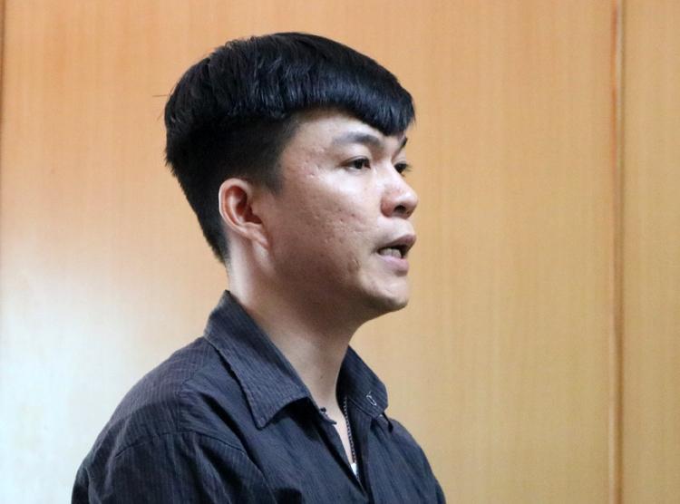 Nguyễn Anh Đạt tại tòa. Ảnh: Trúc Quyên.