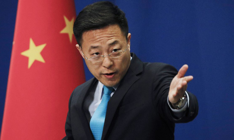 Phát ngôn viên Bộ Ngoại giao Trung Quốc Triệu Lập Kiên trong cuộc họp báo tại Bắc Kinh hôm 24/2. Ảnh: AP.