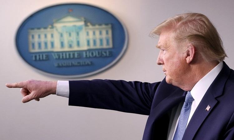 Tổng thống Mỹ Donald Trump tại buổi họp báo về Covid-19 ở Nhà Trắng hôm 16/3. Ảnh: AFP.