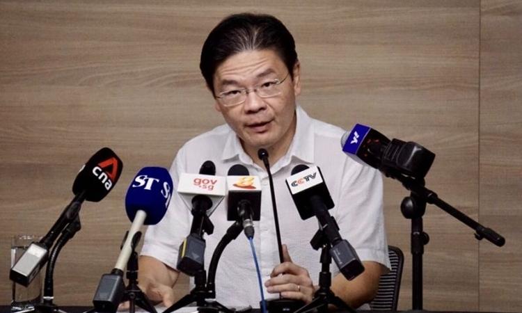 Bộ trưởng Phát triển Singapore Lawrence Wong trong cuộc họp hôm 15/3. Ảnh: Yahoo News.