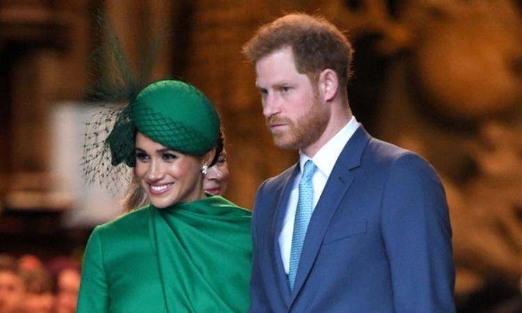 Vợ chồng Harry - Meghan tại sự kiện The Commonwealth Service ở tu viện Westminster, London, Anh, hôm 9/3. Ảnh: AFP.