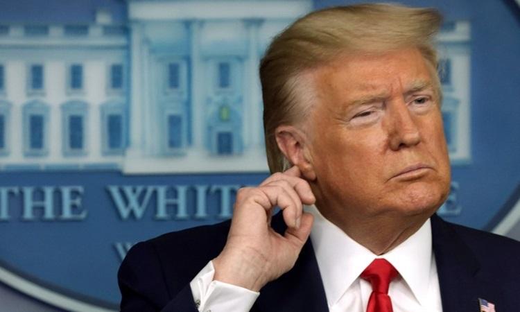 Tổng thống Mỹ Donald Trump tại buổi họp báo Covid-19 ở Nhà Trắng hôm 18/3. Ảnh: AFP.