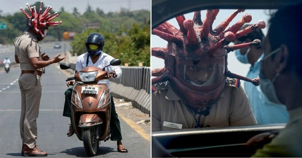 Cảnh sát Rajesh Babu làm nhiệm vụ với chiếc mũ bảo hiểm lạ. Ảnh: Reuters