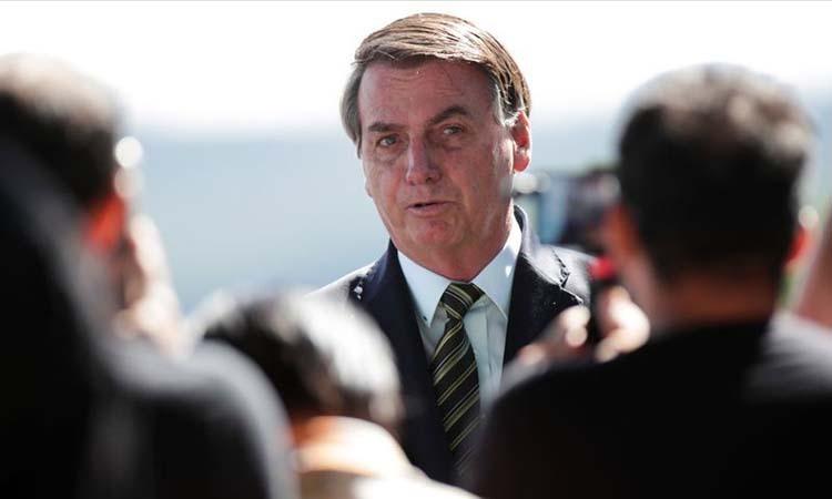 Tổng thống Brazil hục hặc với Bộ trưởng Y tế về Covid-19 - ảnh 1