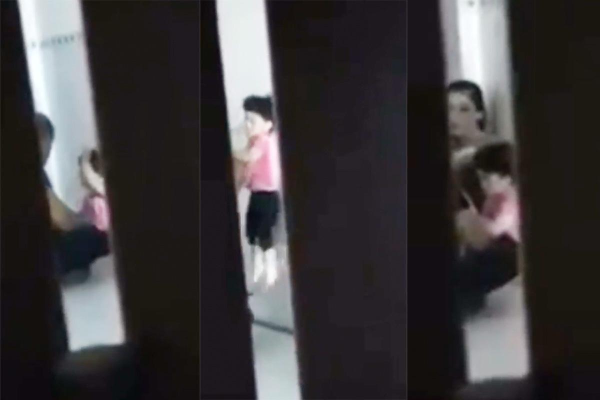 Bé gái bị người đàn ông đánh trong phòng trọ. Ảnh cắt video.